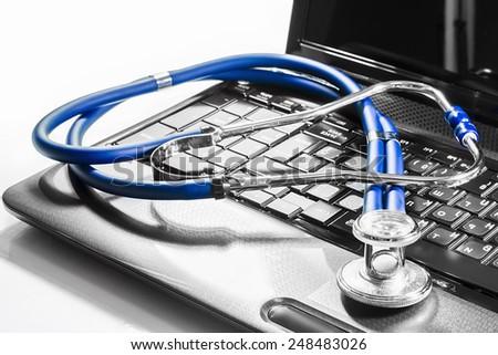stenoskop on laptop repair service maintenance warranty diagnostics - stock photo