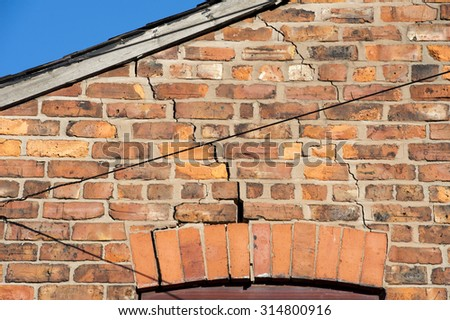 step cracking above a window caused by subsidence  - stock photo