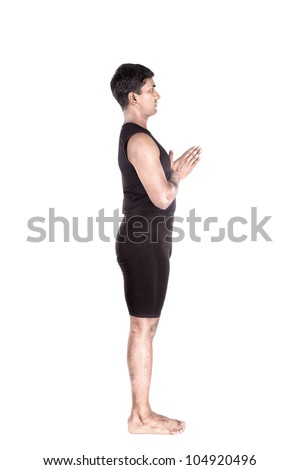 step of surya namaskar, sun salutation Exercise by Indian man in black cloth at white background - stock photo