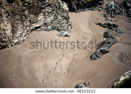 Step on the beach circled by rocks - stock photo