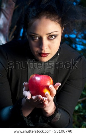 stepmother gives poisoned apple - stock photo