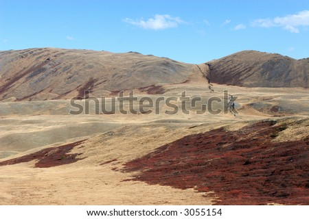 Steppe, mountain and fissure. Altai. Russia. - stock photo