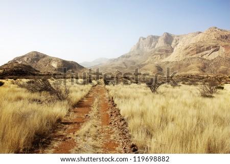 steppe with Erongo mountains in Namibia - stock photo