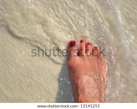 Stepping into ocean waves