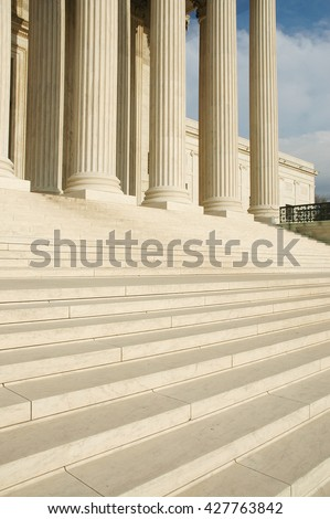 Steps and columns of west portico of United States Supreme Court in Washington, D.C. Seat of judicial branch of government.