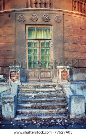 steps and front doors of an old building - stock photo