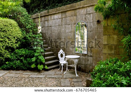 Steps Into An English Country Courtyard Garden With White Wrought Iron  Patio Furniture