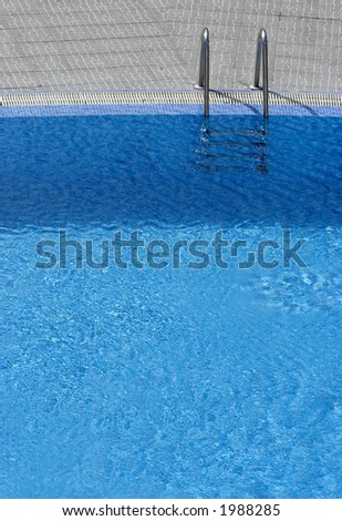 Steps into hotel swimming pool - stock photo