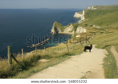 steps leading down to Durdle Door beach - stock photo