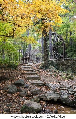 Steps leading to a Magic Mill scene in the Fall - stock photo