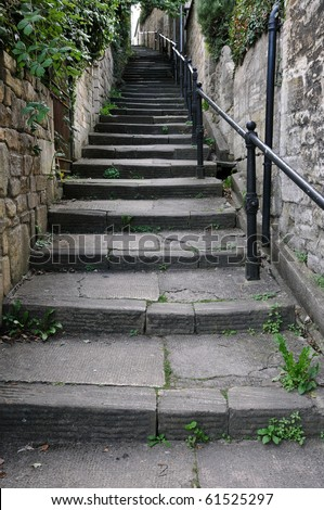Steps Leading up a Narrow Alleyway - stock photo