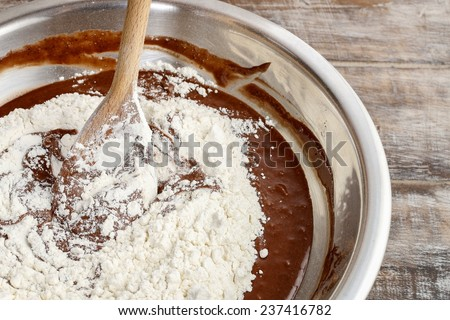 Steps of making chocolate cake : mixing ingredients - stock photo