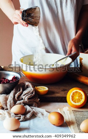 Steps of making cooking sandy cake with cherry filling : mixing ingredients: bowl, flour, eggs,  sour cream. See series. step on step recipe. Cooking course or kitchen mess. Women's hands - stock photo