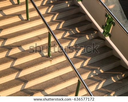 Steps of train station in Bangkok with shadows, Thailand