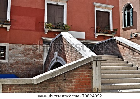 Steps on a bridge over a canal in Venice, Italy - stock photo