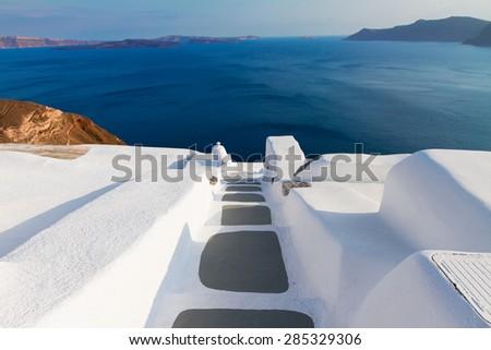 steps to deep blue sea waters, beautiful details of Santorini island, Greece - stock photo