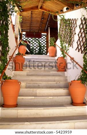 Steps to the greek taverna on terrace - stock photo