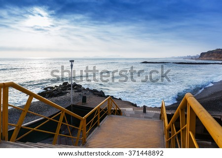 steps to the ocean and sunset - stock photo