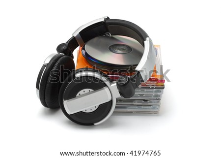 Stereo headphone and compact discs on white background - stock photo