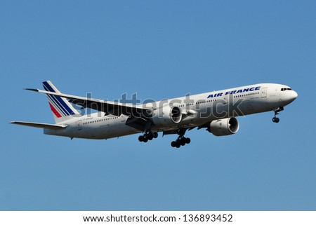 STERLING, VA, USA - NOVEMBER 8, 2011: Air France Boeing 777 lands at Dulles International Airport. Air France is the French flag carrier headquartered in Tremblay-en-France. - stock photo