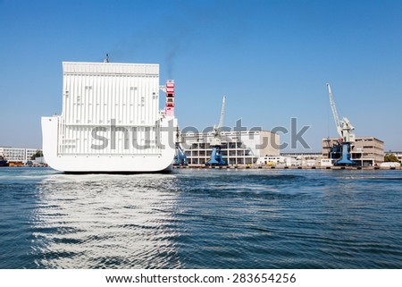 Stern of big white cargo ferry with closed transportation gate, Fish port of Burgas, Bulgaria - stock photo
