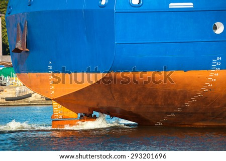 Stern of ship with working screw and rudder. - stock photo
