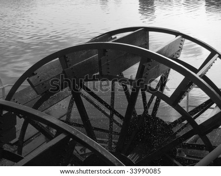 Stern wheel drive on a 155' riverboat providing tours on the North Saskatchewan River below Edmonton, Alberta, Canada - stock photo