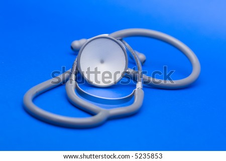 Stethoscope against the blue background.