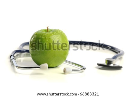 Stethoscope and Apple isolated on a white background - stock photo