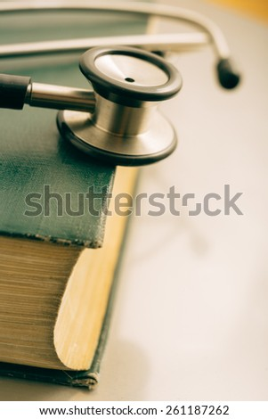 stethoscope and books on white background. - stock photo