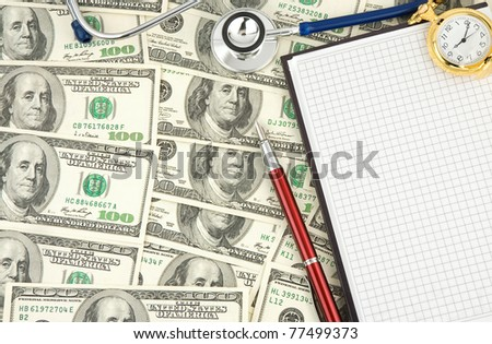 stethoscope and dollars with notebook - stock photo