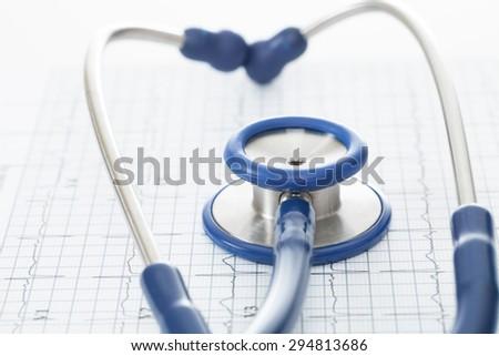 Stethoscope and ekg cardiogram chart - stock photo