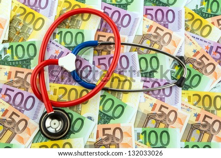 stethoscope and euro banknotes. symbolic photo for health care costs and health insurance and medical - stock photo