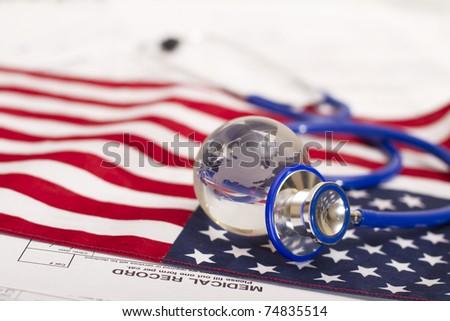 Stethoscope and globe on a USA flag - stock photo
