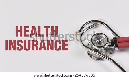 Stethoscope and Health Insurance note on White Background - stock photo