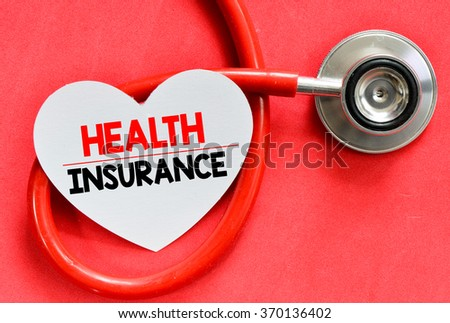 Stethoscope and heart symbol with inscription Health insurance on red background - stock photo