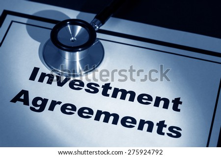 stethoscope and investment Agreement, concept of contract issue - stock photo