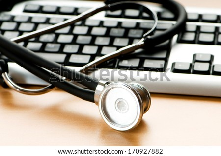 Stethoscope and keyboard illustrating concept of digital security  - stock photo