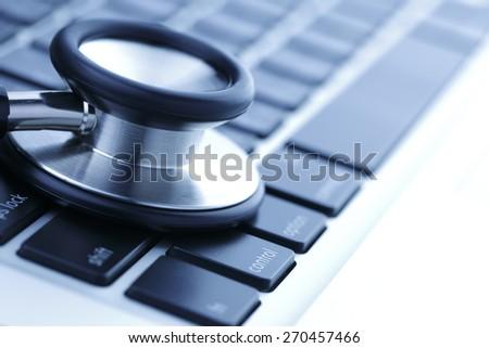 Stethoscope and laptop, blue tone - stock photo