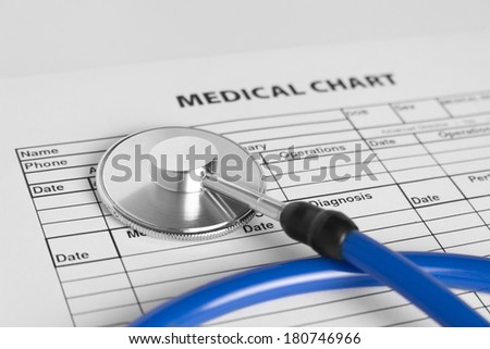 Stethoscope and medical chart - stock photo