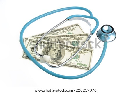 Stethoscope and money isolated on white background - stock photo