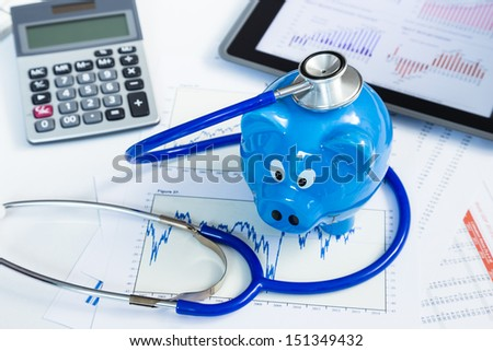Stethoscope and piggy bank for health insurance concept - stock photo
