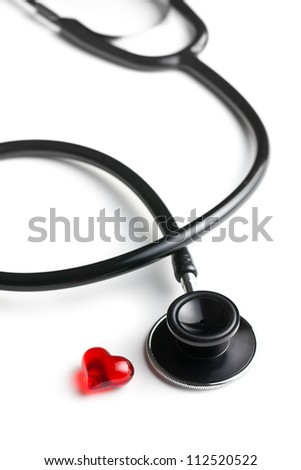 stethoscope and red heart on white background - stock photo