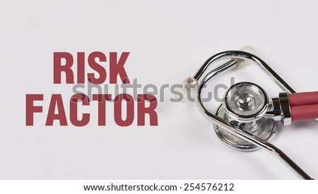 Stethoscope and Risk Factor note on White Background - stock photo