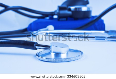 Stethoscope and sphygmomanometer in blue lighting
