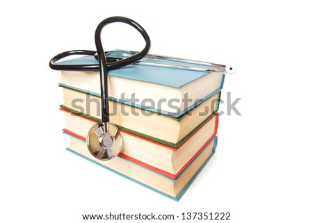 stethoscope and  stack of books isolated on white background. Medical professional education and information concept.