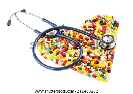 stethoscope and tablets in heart-shaped arrangement, symbol photo for heart disease, diagnosis and medication - stock photo