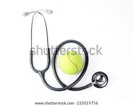 Stethoscope and tennis ball on isolate background - stock photo