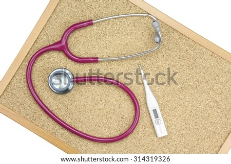Stethoscope and Thermometer on a cork board, Medical equipment. Examining equipment. - stock photo
