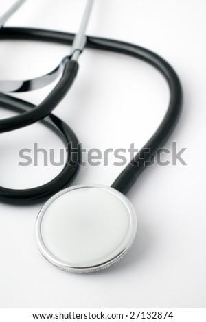 Stethoscope close-up on white background - stock photo